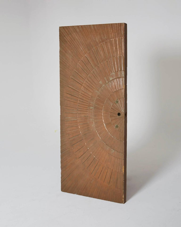 A wildly amazing Mid-Century Modern door by Sherrill Broudy for forms and surfaces, circa 1960, a grandiose bonded and poured bronze door in an abstract Sunburst design. Monumental and stunning, this item comes from deadstock and has never been