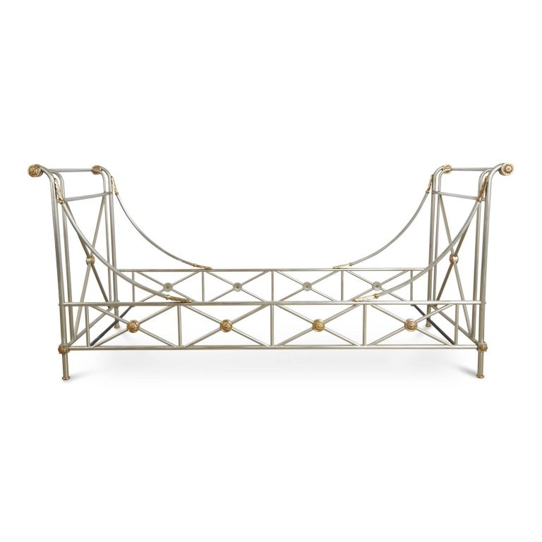Gleaming Maison Jansen brushed nickel daybed with beautiful brass accents. Featuring an elegantly constructed frame with swooping side rails and elevated identical head and foot boards and punctuated with brass medallions as well as arched acanthus