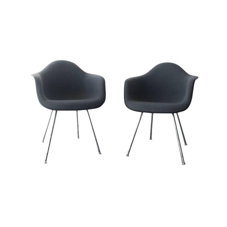 pair of upholstered eames shell chairs by herman miller 1984
