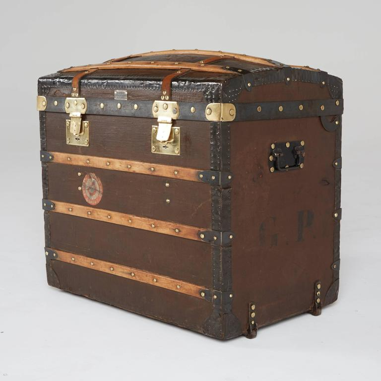 This classic steamer trunk is a fine display of luxury by the oldest French trunk maker, Moynat. Recently restored by a specialized trunk restoration expert, this fine example of history is now ready to be placed into a luxurious setting.  Adorning