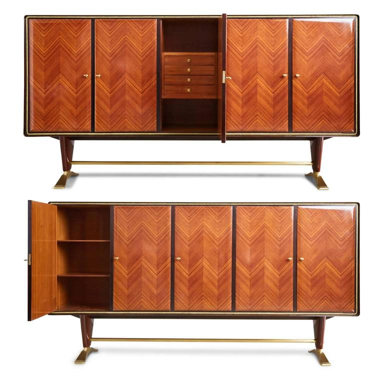 Magnificent Paolo Buffa, attributed, art deco buffet cabinet featuring Italian rosewood parquetry in a chevron pattern with a beautiful french polish and impressive bronze accents with lockable doors complete with five (5) keys. The interior is