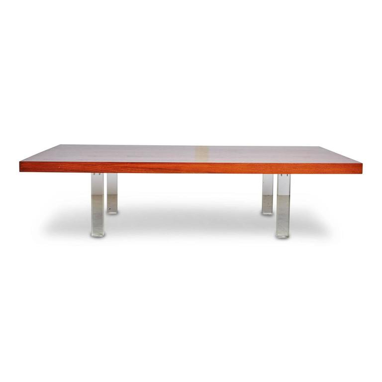 Stunning fully restored Milo Baughman coffee or cocktail table by Directional. The top is fabricated from solid walnut that displays a beautiful grain, which has been newly refinished with a rich stain and features stylish squared Lucite legs.