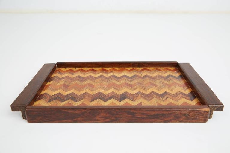 Exquisitely crafted rectangular shaped trays designed by Don Shoemaker for Señal of Mexico. Taking advantage of the expertise provided by Mexican artisans, Shoemaker founded Señal which produced utilitarian objects, such as these stunning