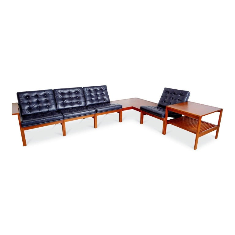 Newly restored Moduline living room set originally designed in 1962 by Ole Gjerløv-Knudsen & Torben Lind for France & Son. The teak tables and seating frames of this modular set were recently refinished and the seat cushions were newly reupholstered