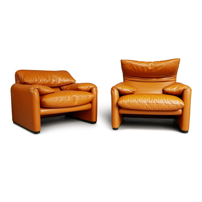 Wonderful pair of Vico Magistretti's award-winning 1973 Maralunga chairs for Cassina. Featuring the original sumptuous tan leather upholstery which has been kept in excellent condition and shows an admirable patina. These traces of age and use bring