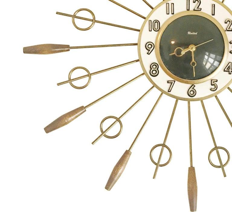 Mid-Century Modern United Brass Spindles Sunburst Clock, circa 1950 For Sale