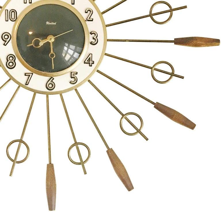 British United Brass Spindles Sunburst Clock, circa 1950 For Sale