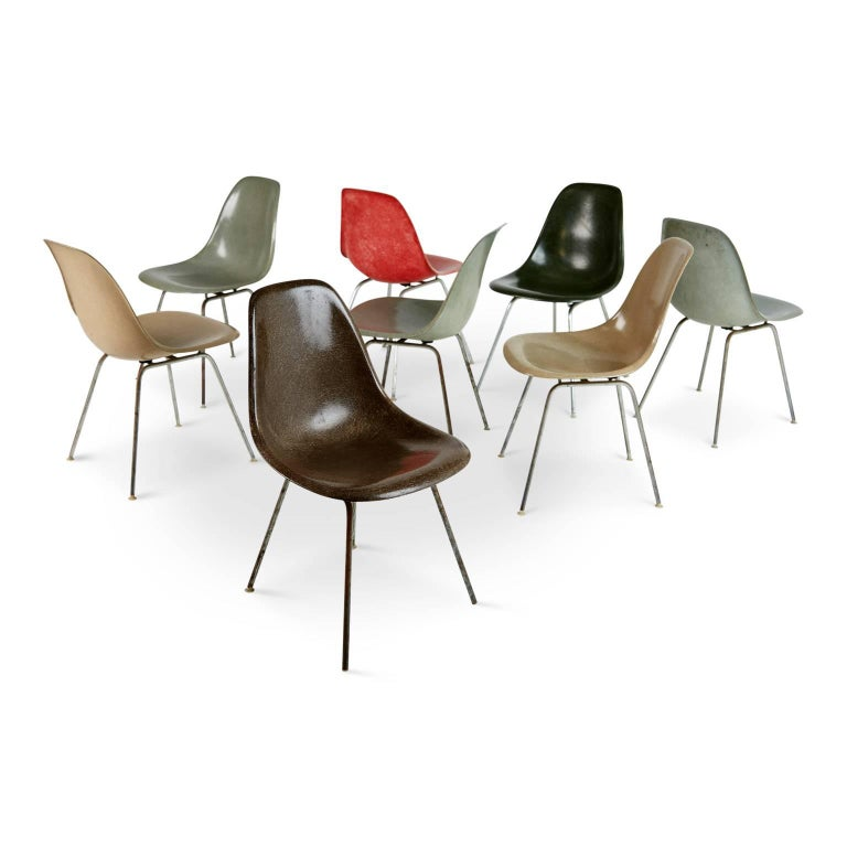 "A colorful collection of early production Charles and Ray Eames ""scoop"" side chairs manufactured by Herman Miller. These shell DSX chairs are fabricated from fiberglass and mounted on chrome-plated steel bases. This set of eight dining chairs come"