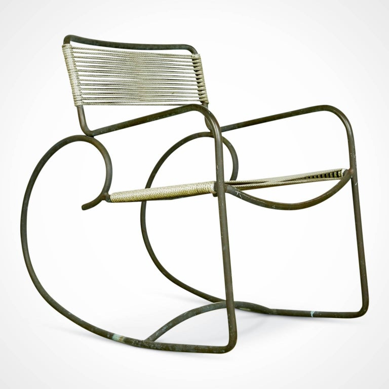 Bronze rocking chair designed by Walter Lamb and manufactured by Brown Jordan. A rarity with the original label still in-tact as these, being usually used outdoors, tend to lose the labels on the lower cross-bar. This, plus its excellent original