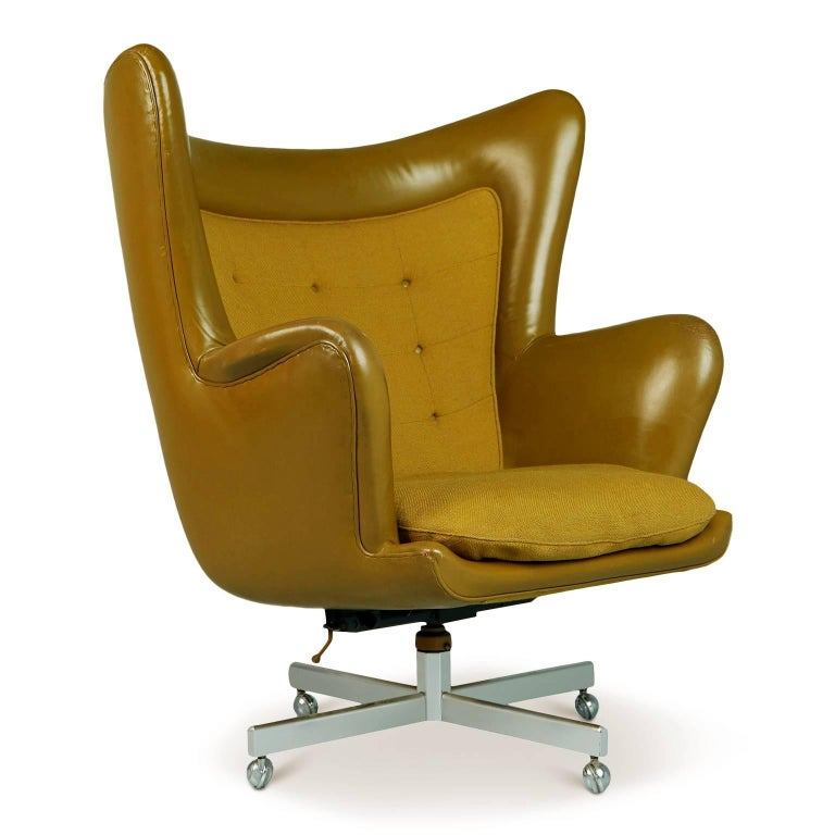 A very rare and impressively proportioned executive wingback chair by George Kasparian. Perfect for the collector who already has everything, this chair is a blend of executive desk chair and throne chair.   *NOTE, we have a second chair and