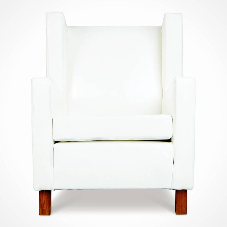 Wonderful pair of white leather lounge chairs from Brazil. Featuring solid block feet fabricated from Jacaranda Rosewood with a beautiful grain and recently reupholstered in a premium white leather. This pair display the use of clean minimal design