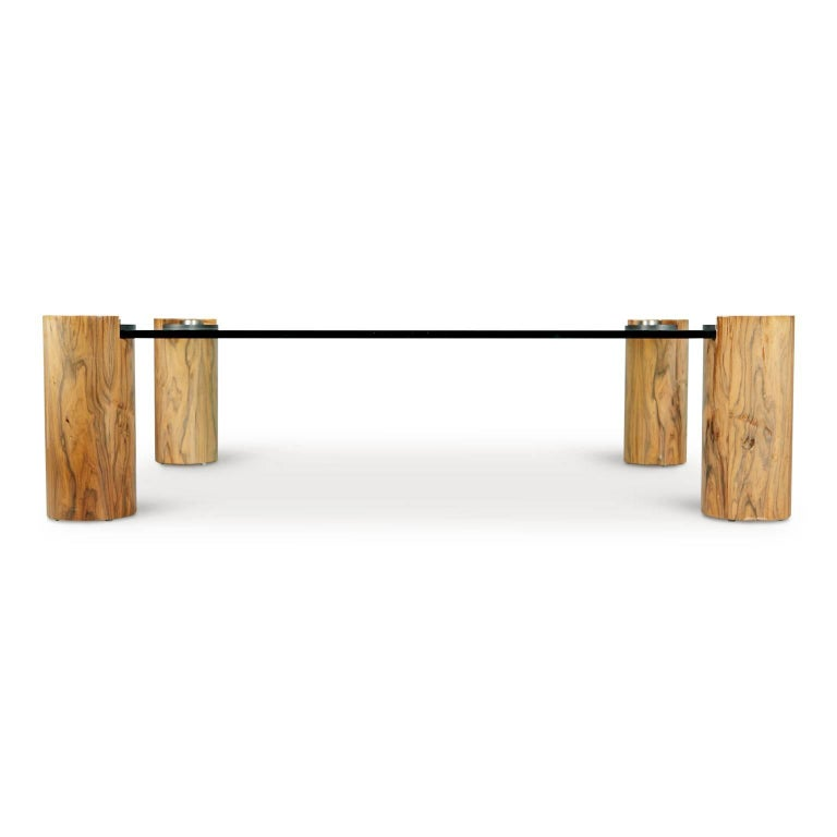 Known for his striking designs and use of exotic woods and luxurious materials, this cocktail table is an excellent example of Karl Springer's work. This expansively proportioned cocktail table displays Springer's keen sensibility for luxury and
