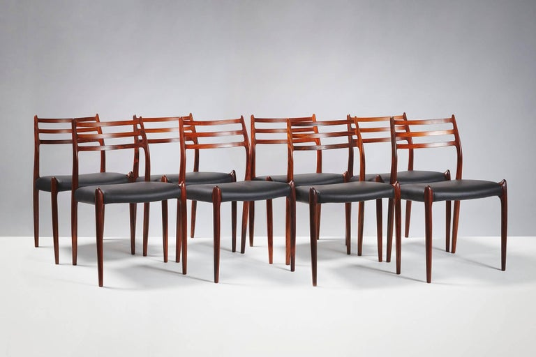 Niels O. Møller  Model 78 dining chairs, 1962  Set of eight rosewood dining chairs designed by Niels O. Møller for J.L. Moller Mobelfabrik, Denmark, 1962. Seats reupholstered with premium black leather.  Larger sets and other upholstery