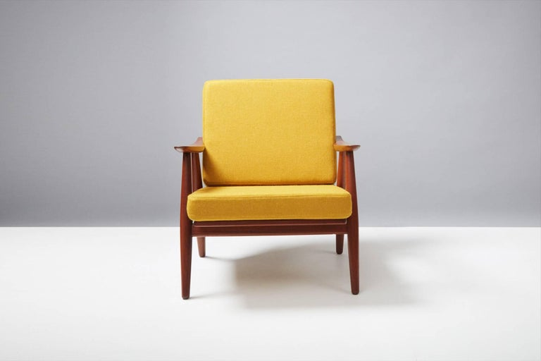 Hans J. Wegner  GE-270 lounge chair, 1956  Produced by GETAMA, Gedsted, Denmark. Restored teak frame with exposed brass fittings. New cushions covered in bute wool fabric.