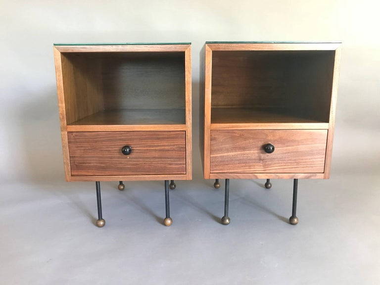 A rare pair of early California Modern designs.  Made of plywood with walnut veneer with a nice grain, wood ball handles and feet with iron and original screws.  The wood has been lightly refinished without taking away from its' historical