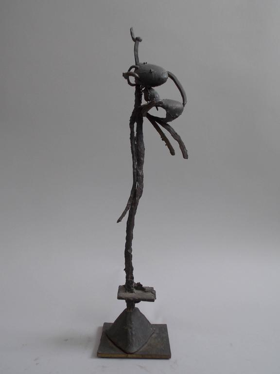 An interesting yet handsome piece of modern art, with an organic insect like form. Made of cast bronze No signature.  It's probably a one-off. A nice decorative form in space.