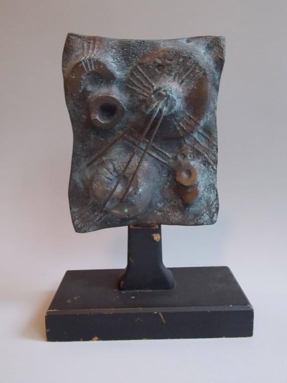 This sculpture might have been a maquette sample.  Made of cast bronze on painted wood base. The base shows minor wear. No damage or repairs.