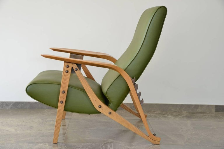This is a beautiful early re-issue Gilda chair by Carlo Mollino from the 1980s. The chair is approx. 38 yrs old and the wood has gathered a nice creamy patine. Only age can do this. There is some light wear and tear on the wooden parts but these