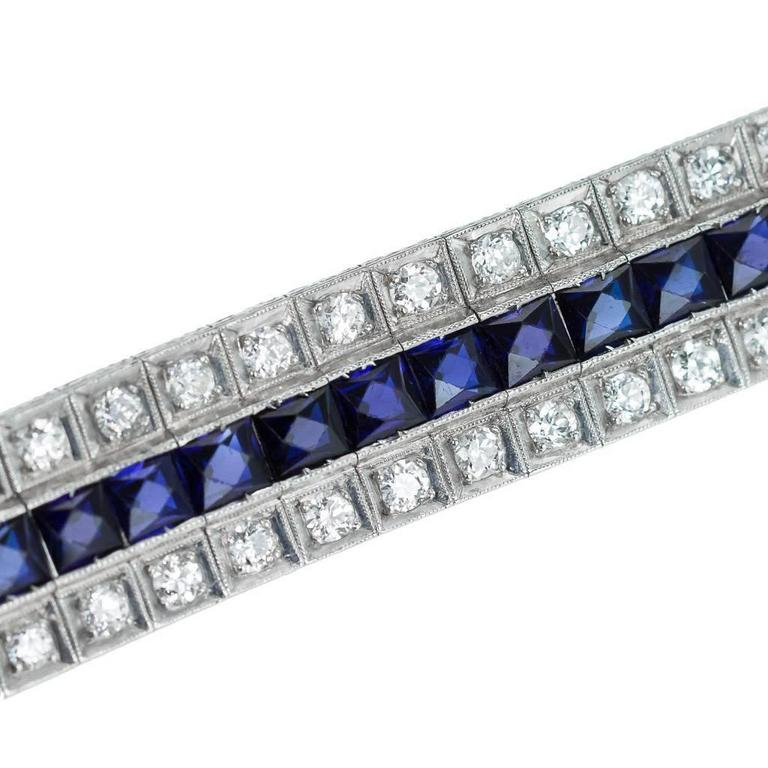Description:  Antique 20th century Art Deco exceptional platinum, sapphire and diamond bracelet, designed as three rows set with 80 round cut diamonds and 40 square-cut sapphires. The work closely reminds of the Art Deco pieces made by Tiffany &