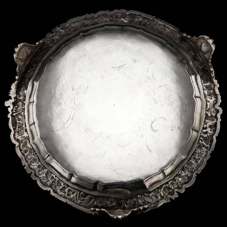 Antique 19th century rare and exceptional George IV solid silver salver tray with cast border, large size and extremely heavy gauge, of shaped-circular form with applied cast border depicting grapevine and Mythological figures, probably allegories