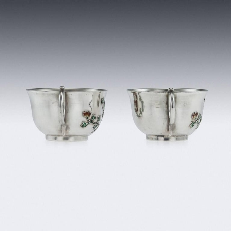 Antique 19th century extremely rare Chinese solid silver and enamel pair of tea cups and saucers, the sides are applied with cloisonné enamel, depicting chrysanthemum flowers. The tea cups are of good traditional size and features stunning