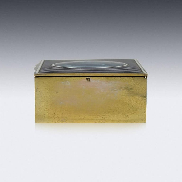 Antique 20th century French solid silver and hand-painted enamel jewelry or cigarette box, of plain rectangular form, body gilded and hinged cover applied with enamel bands and central plaque has an exceptionally well-painted Romantic scene: a lady