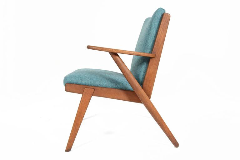 Scandinavian Modern Paddle Arm Lounge Chair in Stained Oak For Sale