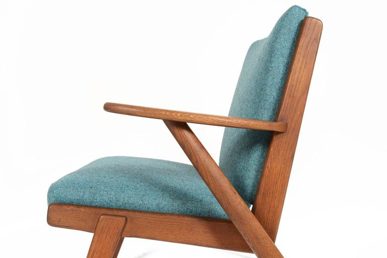 Danish Paddle Arm Lounge Chair in Stained Oak For Sale
