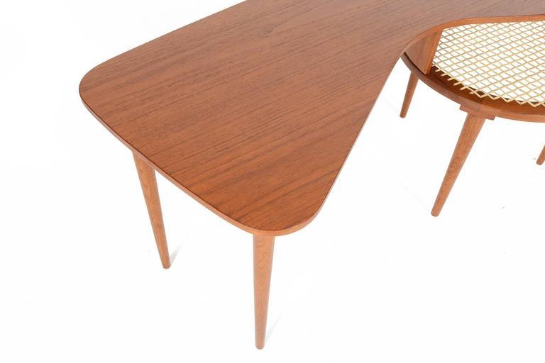 Scandinavian Modern Teak Boomerang Table With Caned Rack For Sale