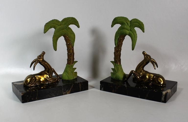 French Art Deco spelter antelope bookends with marble bases.
