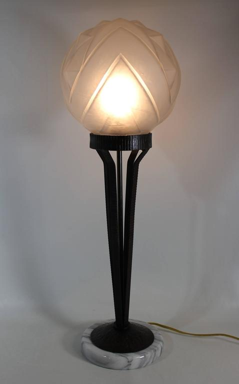 Beautiful cast iron Art Deco lamp with marble base.