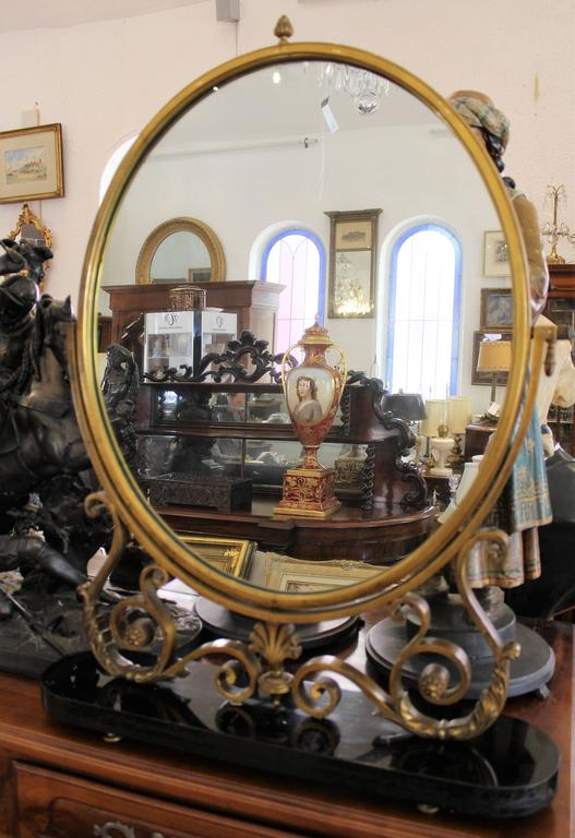 Stunning French Art Deco bronze swivel table mirror.