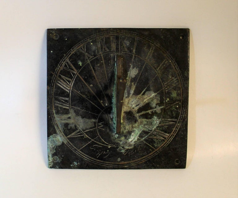 19th century bronze sundial with text and roman numerals and beautiful aged patina.