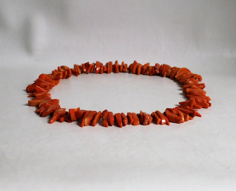 Salmon color coral necklace.