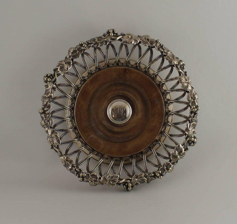 Set of four Elkington silver plated wine coasters.