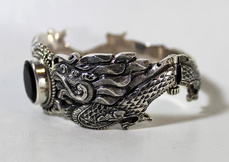 Nepalese sterling silver and onyx dragon bracelet. Weight: 90 grams.