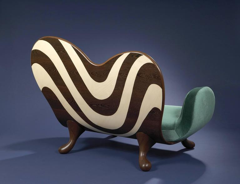 Surf. Cat-Berro Edition 2006.  Sofa. Veneer of wenge and sycamore wood. Sculpted wenge wood feet. Fabric: Wool velvet. H: 43 ¾''. D: 37 ½ ''. W: 57''. H: 111cm. L: 152 cm.P: 95cm. Signed piece of a limited edition of 8 + 2AP + 2P. Delivery time: 10