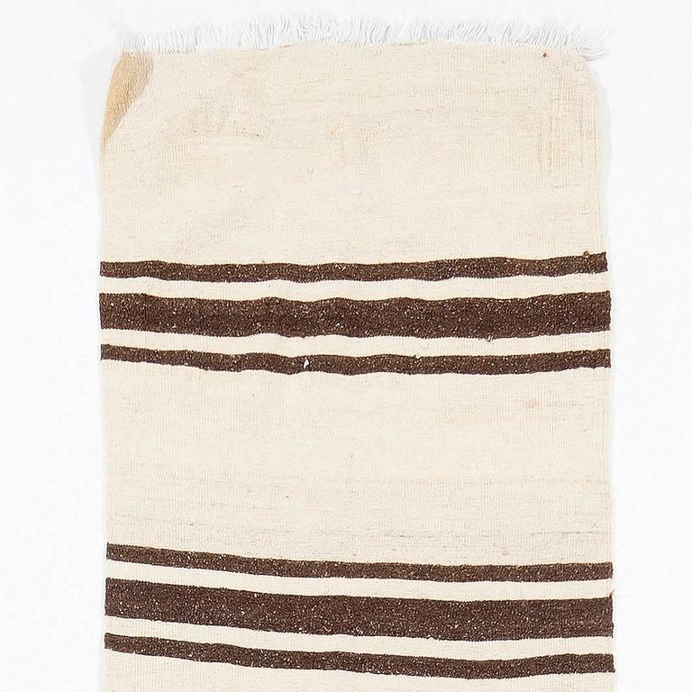 Size: 2.4 x 15.1 ft (70 x 460 cm) - Adjustable.  This beautiful and simple flat-woven runner is made of natural un-dyed wool in shades of brown and beige. It is woven by villagers in Central Anatolia, Turkey around mid-20th century for domestic