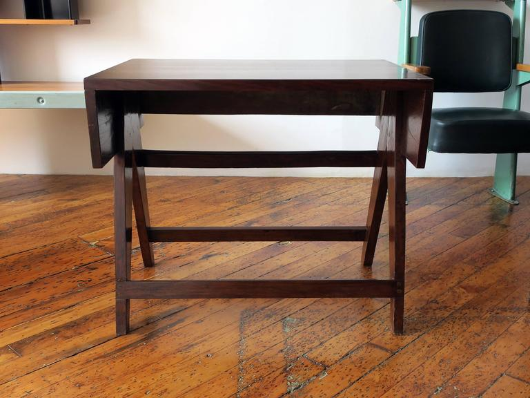 Teak student desk from the administrative building of the modernist city, Chandigarh, designed by Le Corbusier and Pierre Jeanneret. Functions well as a console.