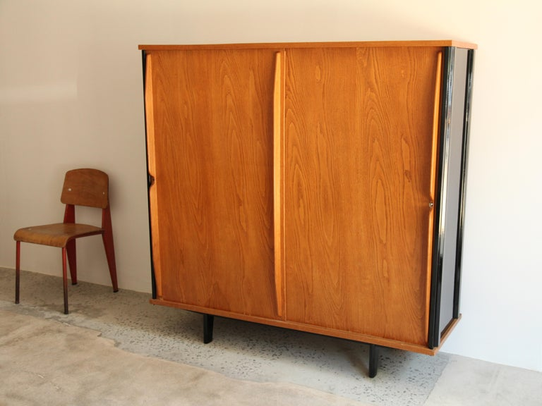 Cabinet model AG11 variant with lock by Jean Prouve and executed by Ateliers Jean Prouvé, circa 1947. Black lacquered steel, solid oak and oak plywood.