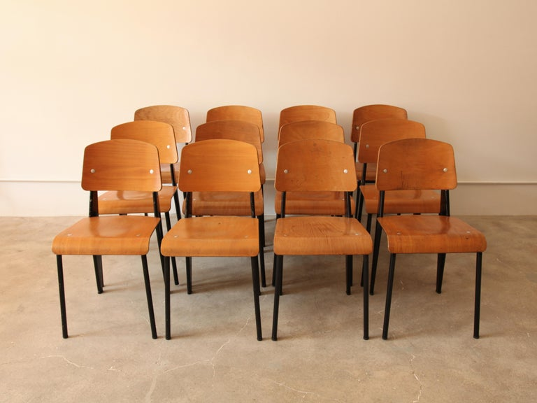 Monumental set of 12 'Semi-Metal' No. 305 chairs by Jean Prouve, and manufactured by Ateliers Jean Prouvé, France, c.1950. Enameled steel and beech plywood. 
