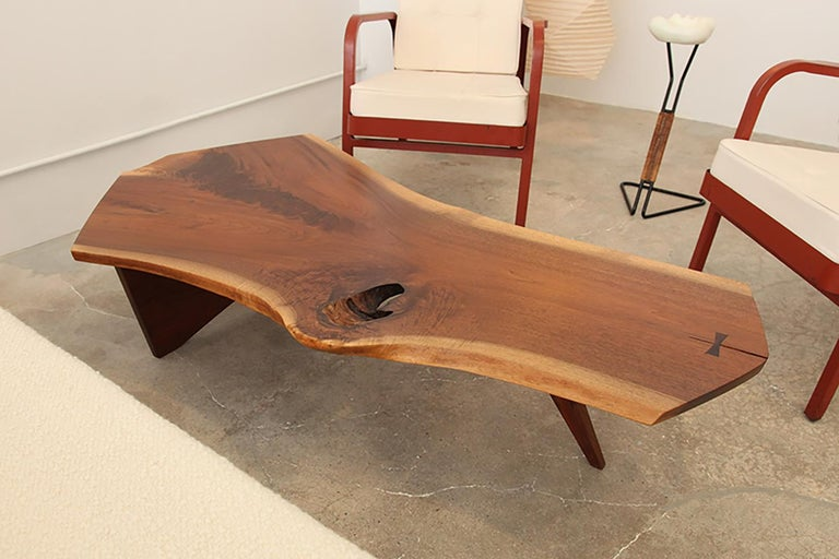 A beautiful and soulful, free-from slab coffee table in walnut by George Nakashima, New Hope, PA, circa 1960. Marked underneath with clients name.