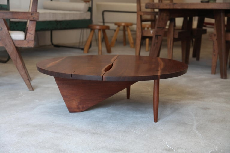 A beautiful walnut coffee table designed by George Nakashima, circa 1960s. Split visible from top is not damage and is contained with a hidden butterfly on the underside (see Image).