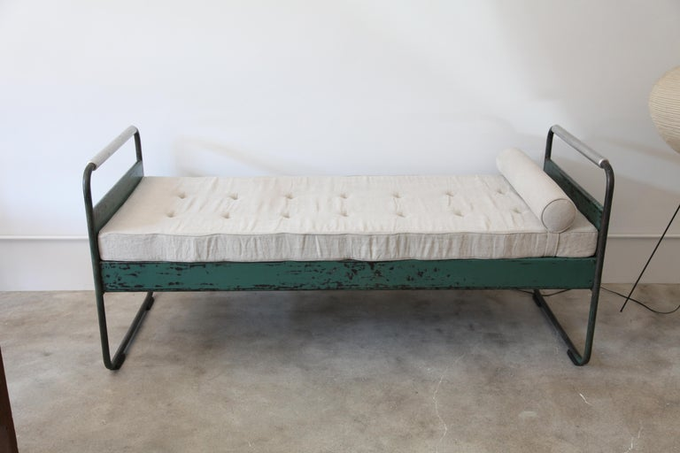 A great early Jean Prouvé bed, circa1935 from the Lycée Fabert, Metz.   Original paint. Cushion is a newer replacement.