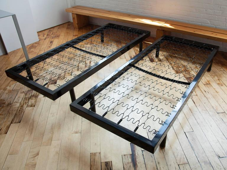 Great pair of Jean Prouvé S.C.A.L. bent sheet steel and steel tube bed frames manufactured by Ateliers Jean Prouvé. These beds were made in the early years of World War II for the staff dormitories at the S.C.A.L. plant in Issoire.