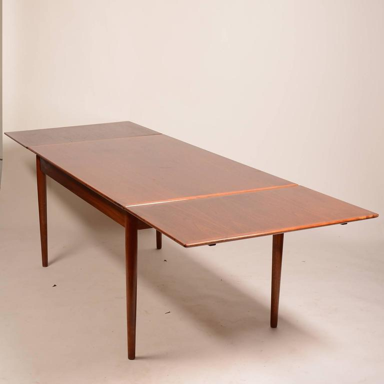 Large danish modern draw leaf dining table in teak for for Big modern dining table