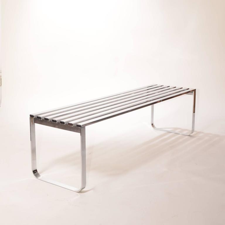 Vintage chrome bench by Milo Baughman for the Design Institute of America in great vintage condition. Has light wear on the top surface. Retains DIA sticker.