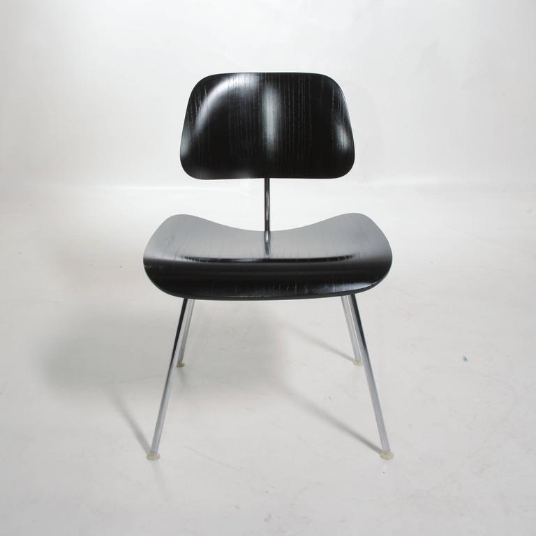 We have 4 black DCM (dining chair metal) chair by Charles and Ray Eames for Herman Miller. Original and in great condition.
