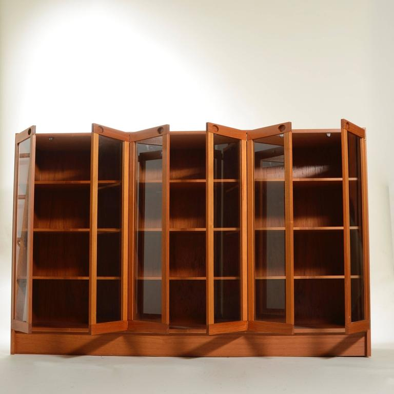 This beautiful Danish teak cabinet makes a stylish storage option for any room. Spacious and fully adjustable offering a nice variety of organizational space.  In excellent condition.