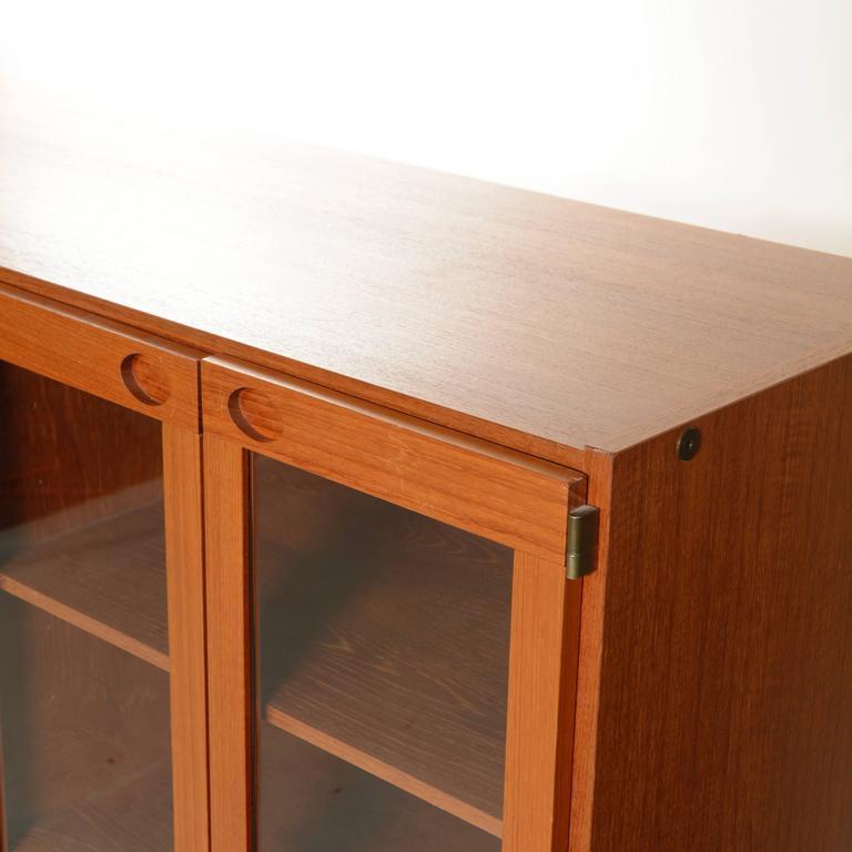 Late 20th Century Mid-Century Modern Danish Teak Glass Door Cabinet For Sale